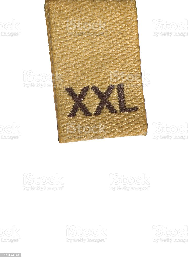 XXL size clothing label tag, isolated macro closeup studio shot stock photo