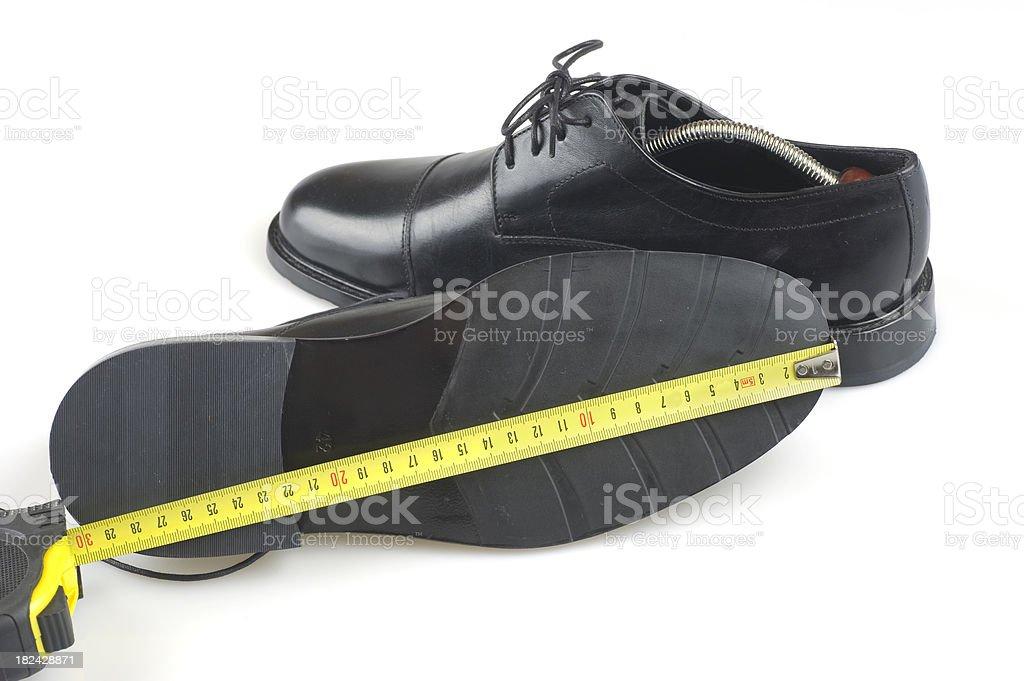size of business shoe - Schuhgröße messen royalty-free stock photo