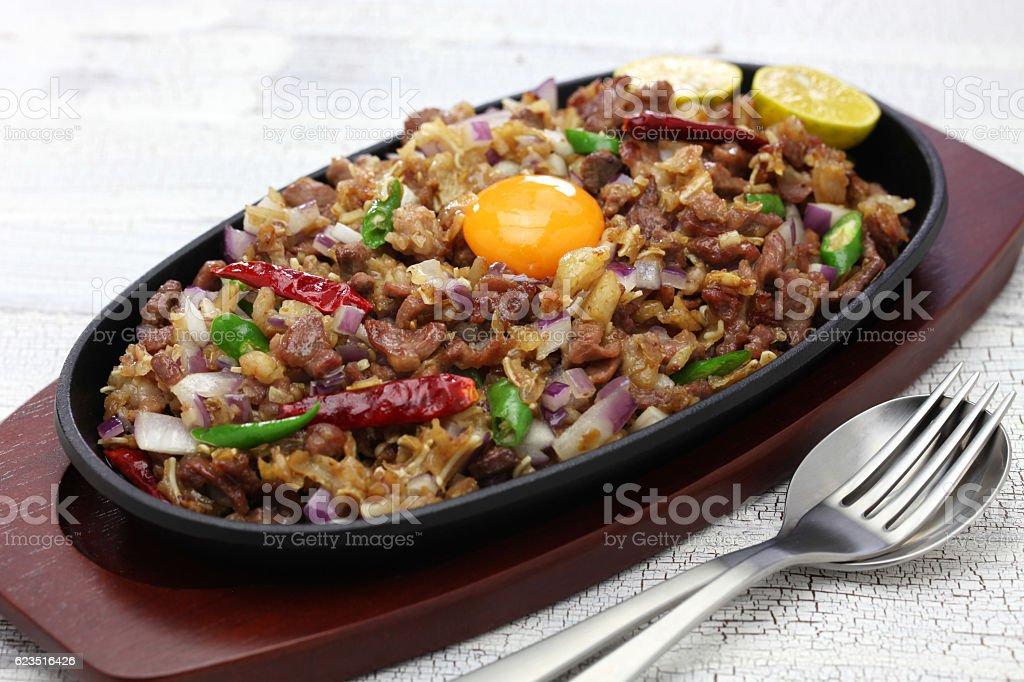 sizzling pork sisig, filipino cuisine stock photo