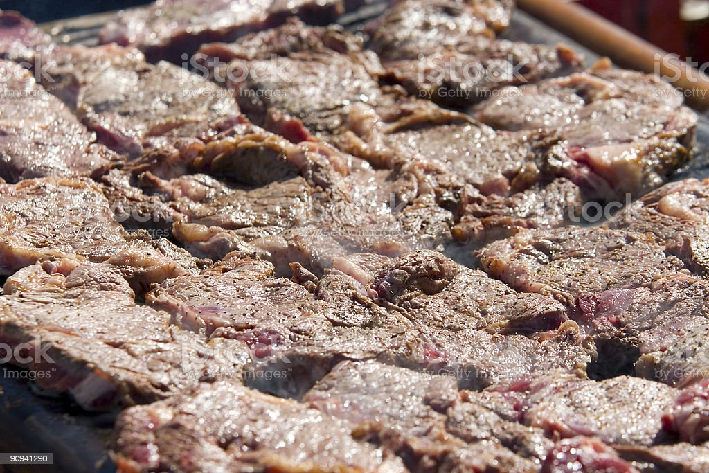 Sizzling Steak on a Barbecue royalty-free stock photo