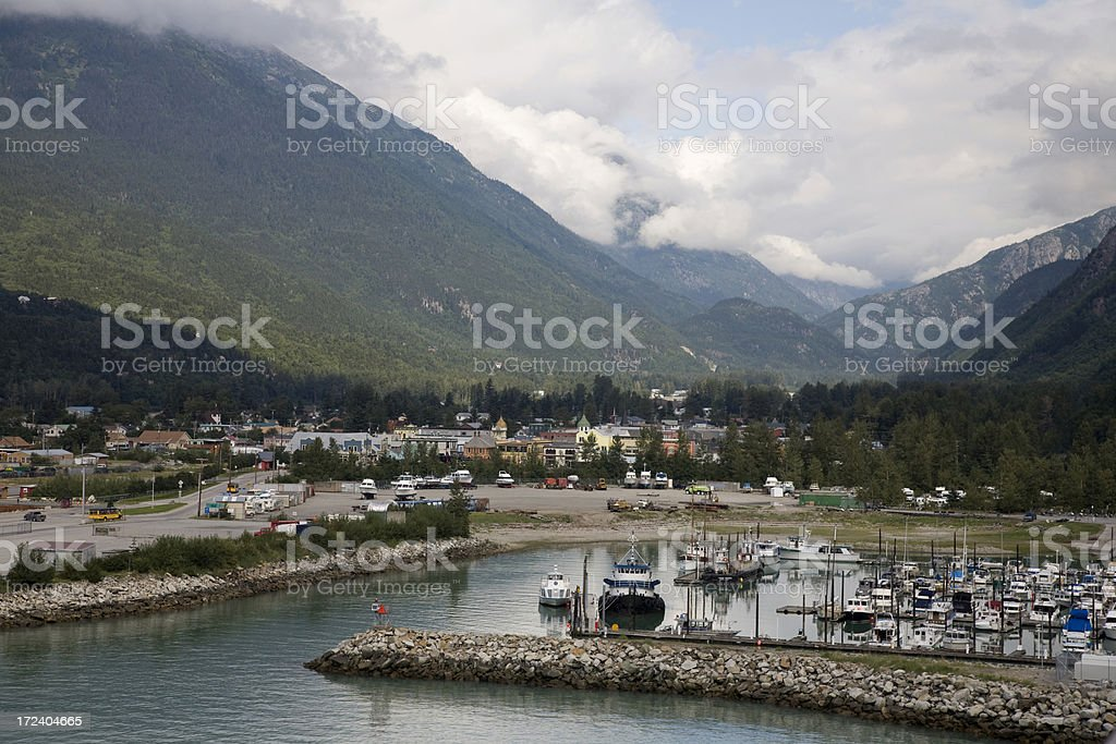 Skagway, Alaska with Mountains and Small Boat Harbour stock photo