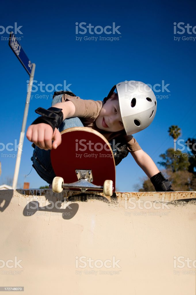 Skate Boarding Kid Next To The LA River royalty-free stock photo