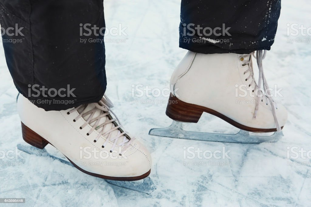 skate boots on teen girl feet close up photo stock photo