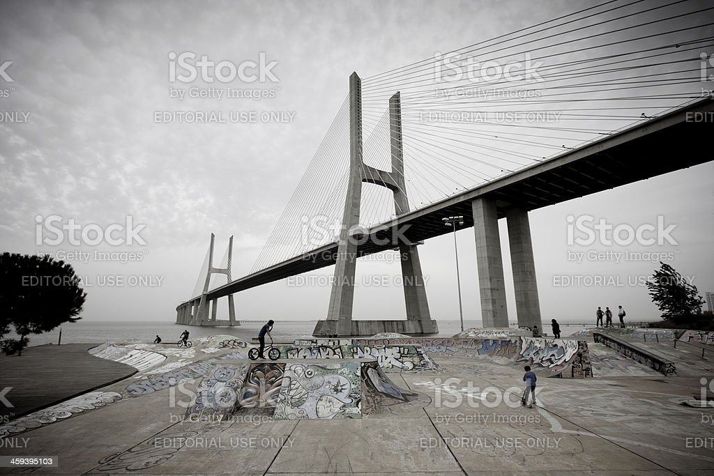Skate park under Vasco da Gama bridge stock photo