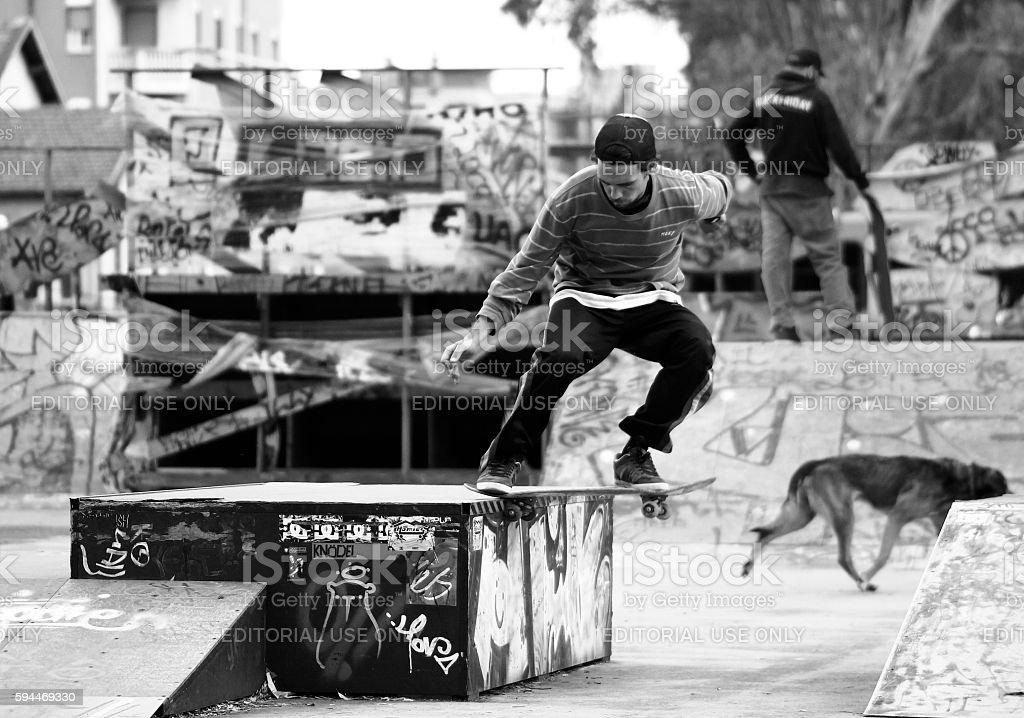 skate slide trick stock photo