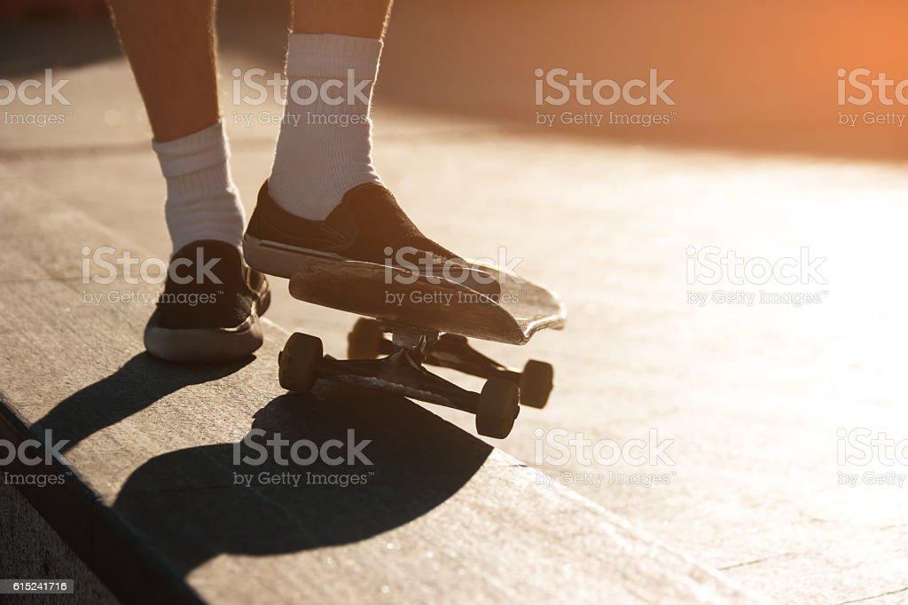 Skateboard and feet. stock photo