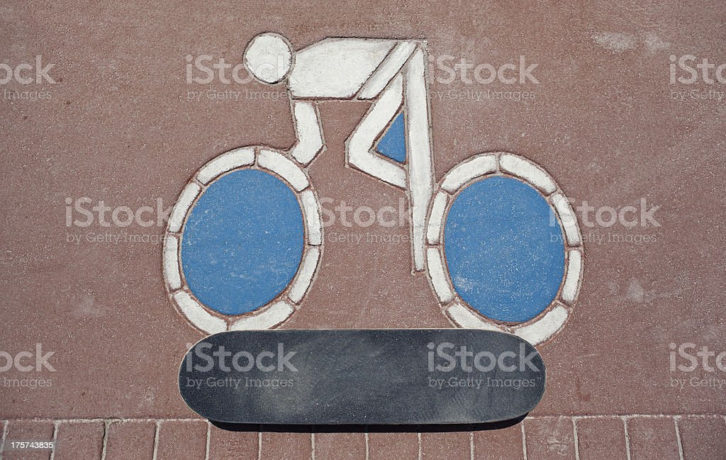 skateboard and street sign royalty-free stock photo