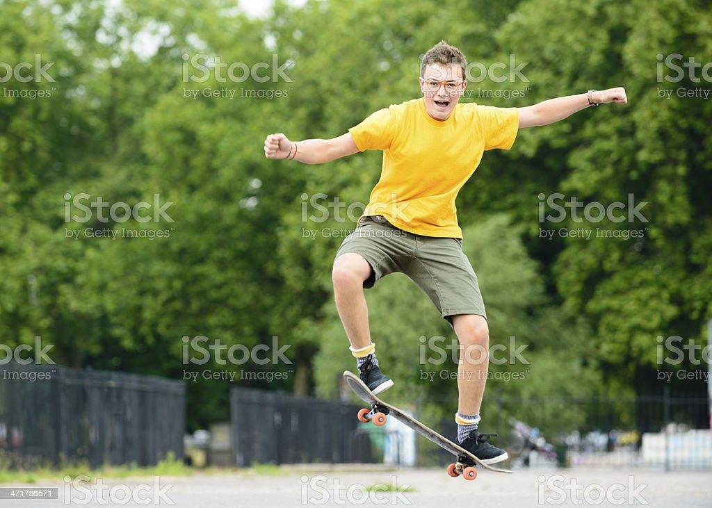 Skateboard Jump by Teenage Boy royalty-free stock photo