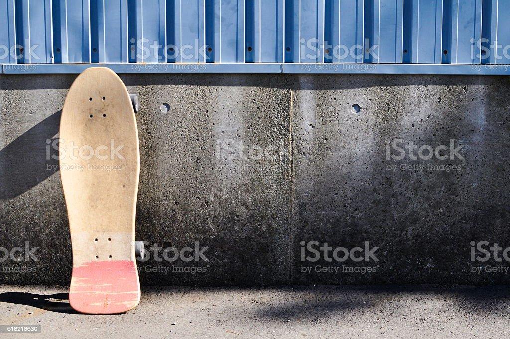 skateboard on concrete wall stock photo