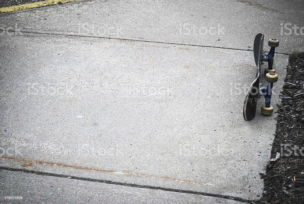Skateboard on Sidewalk royalty-free stock photo
