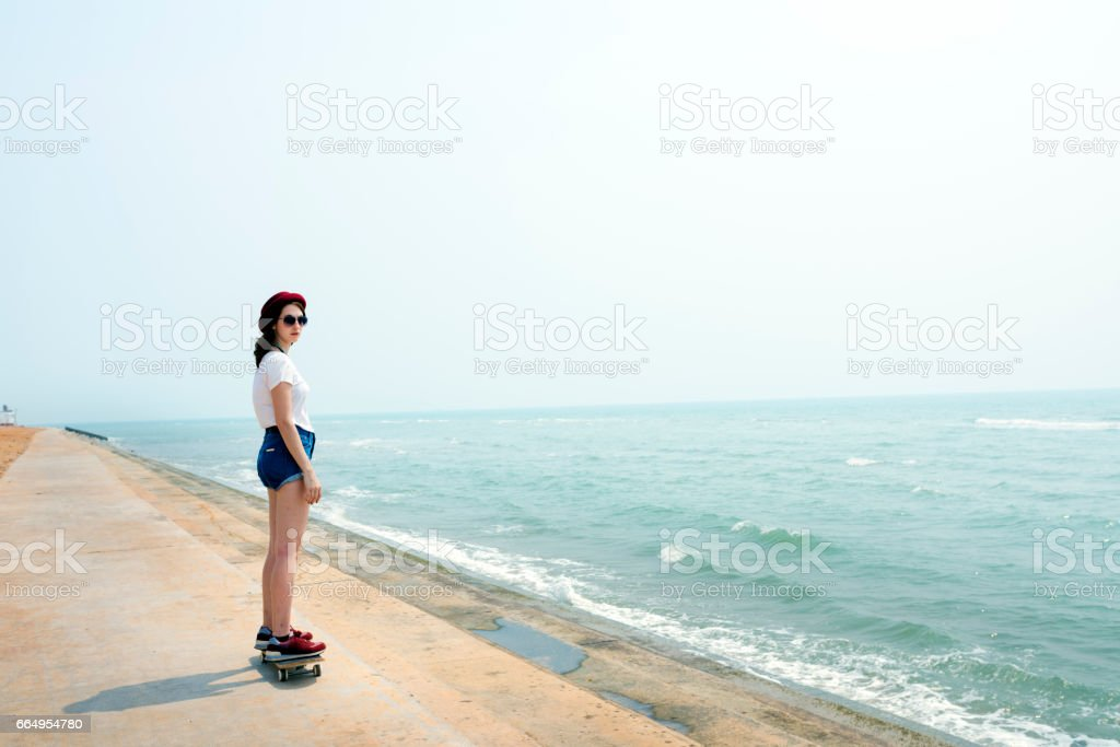 Skateboard Recreational Pursuit Summer Beach Holiday Concept stock photo