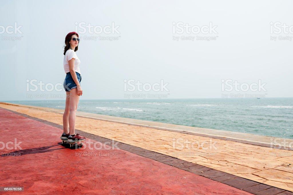 Skateboard Recreational Pursuit Summer Beach Holiday Concept stock photo