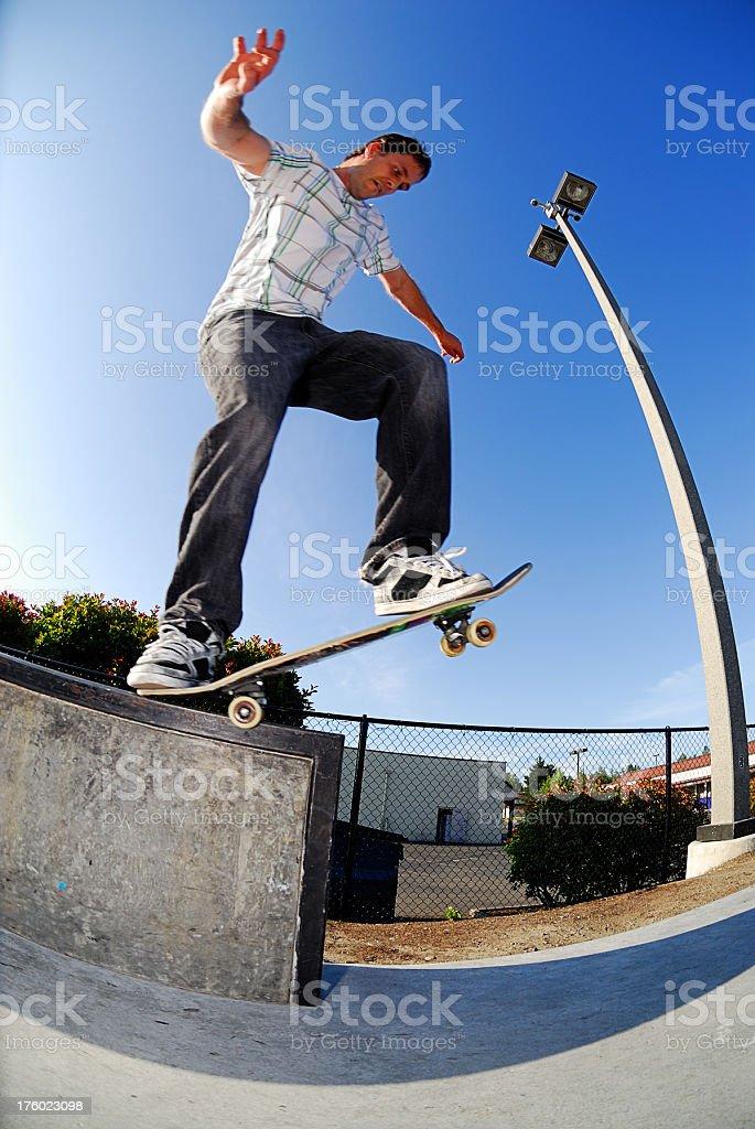 Skateboarder - Backside 5-0 Grind royalty-free stock photo