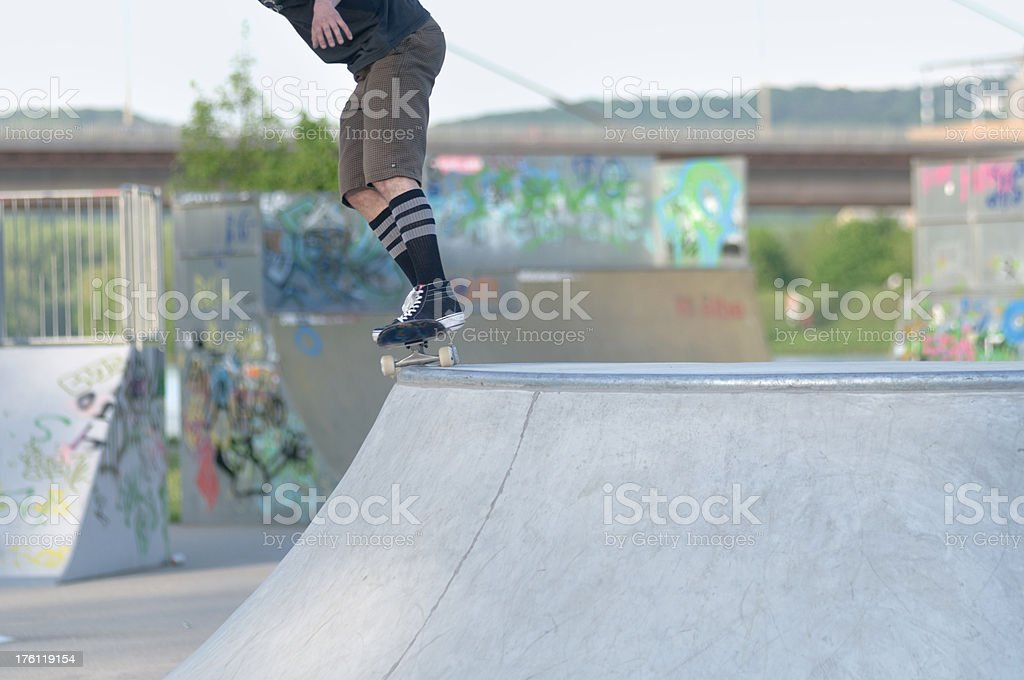 skateboarder doing a 50-50 grind stock photo
