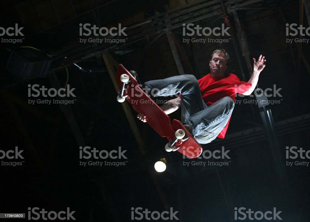 Skateboarder doing a jump in the air. Copy Space Available stock photo