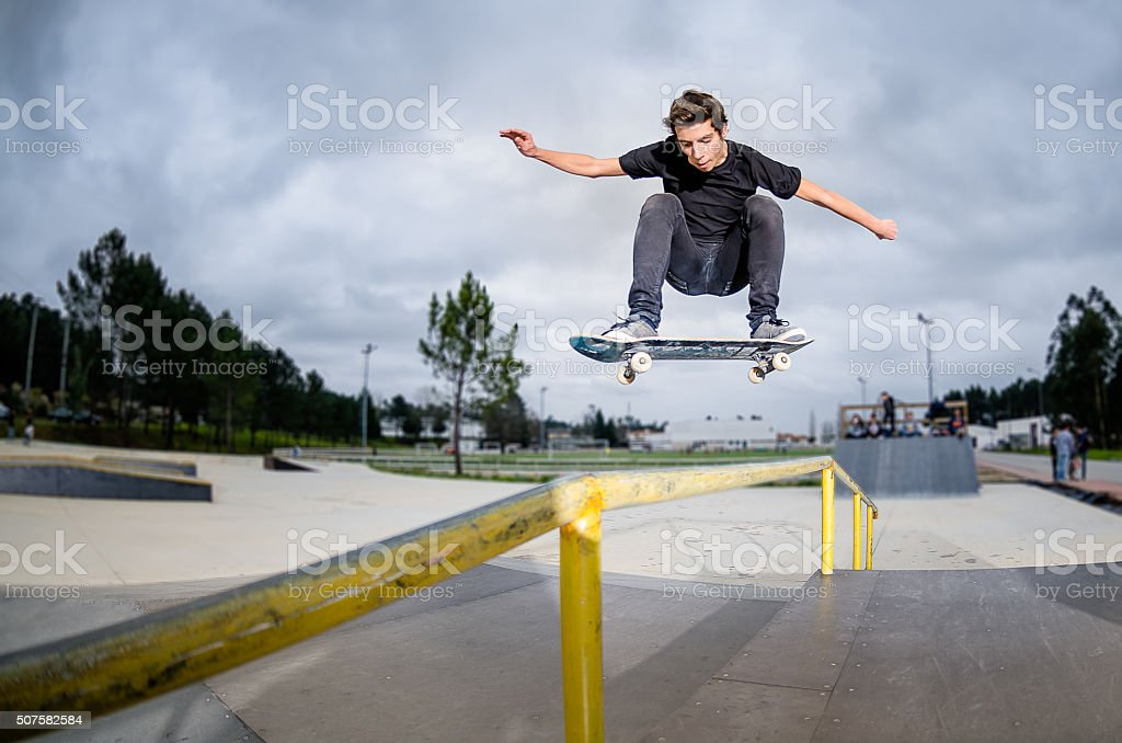 Skateboarder doing a ollie stock photo