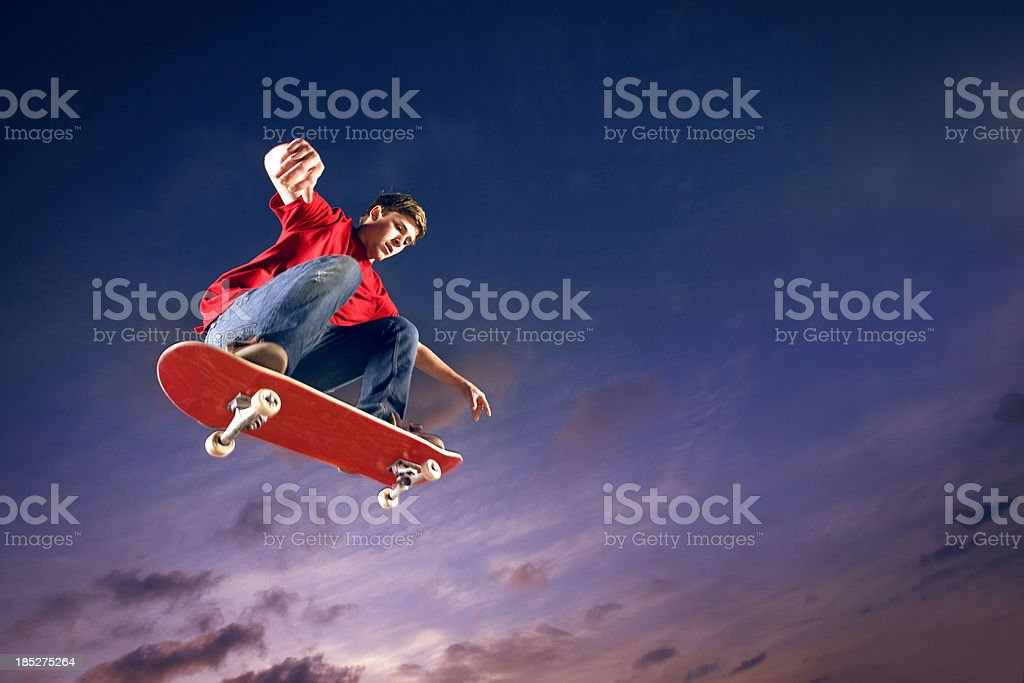 Skateboarder flying through the air stock photo