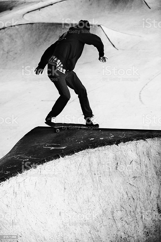Skateboarder Grinding in Black and White royalty-free stock photo