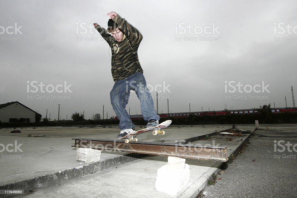 skateboarder grinding royalty-free stock photo