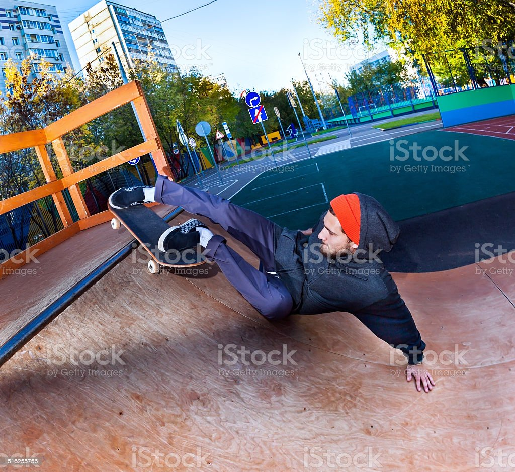 Skateboarder in skatepark stock photo