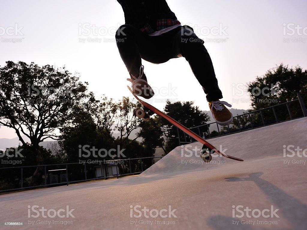 skateboarder jump at skatepark stock photo