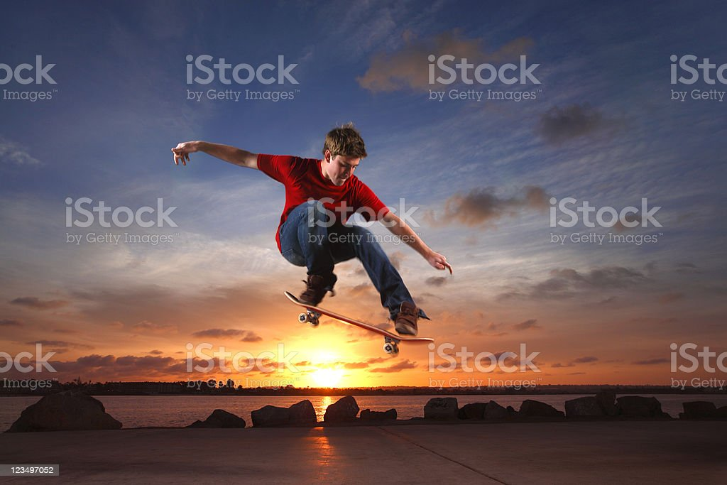 skateboarder leaping over the sun royalty-free stock photo