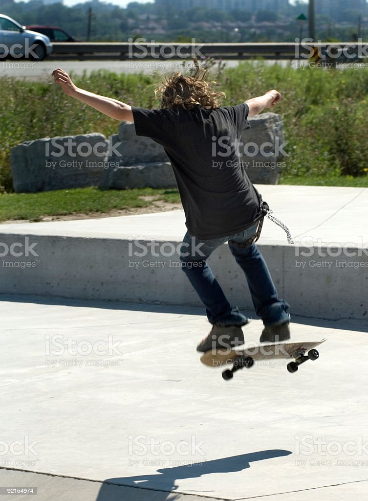 Skateboarder practicing royalty-free stock photo