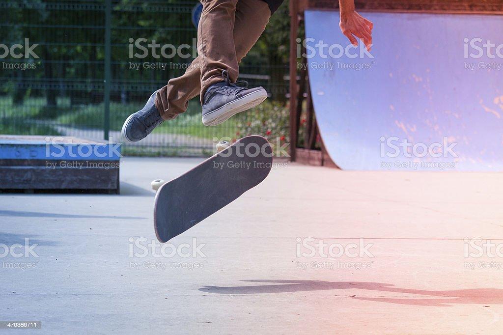 Skateboarder riding skateboard at skate park. stock photo