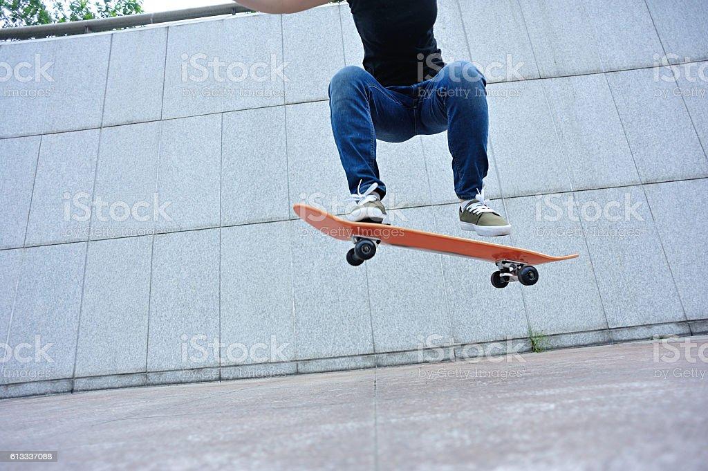 skateboarder skateboarding at city stock photo