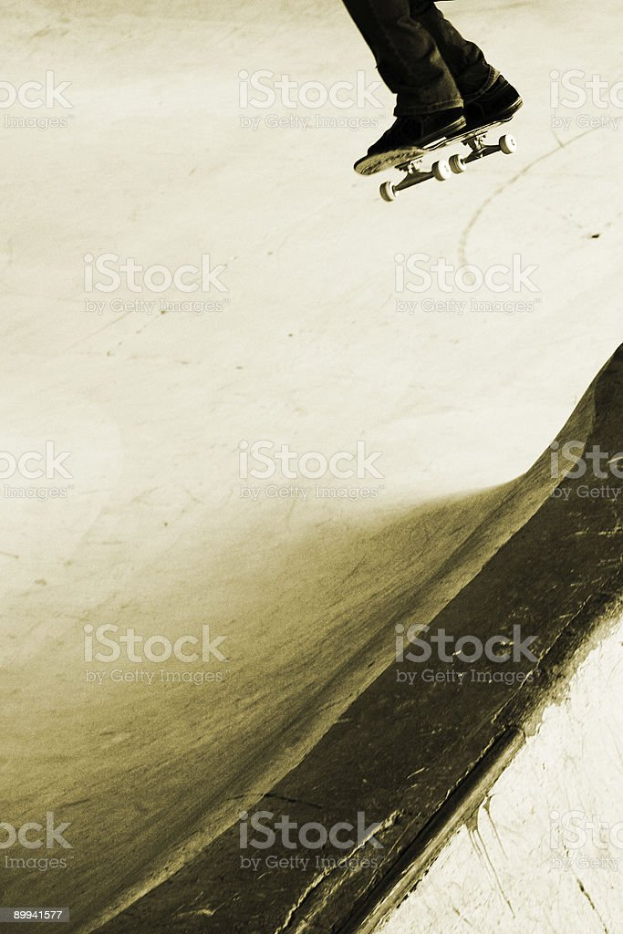 Skateboarder Skating off a Ledge into the Air royalty-free stock photo