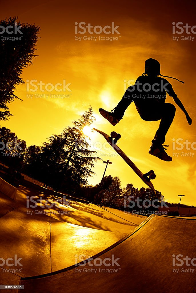 Skateboarder - Sunset Kickflip royalty-free stock photo