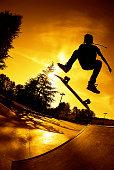 Skateboarder - Sunset Kickflip