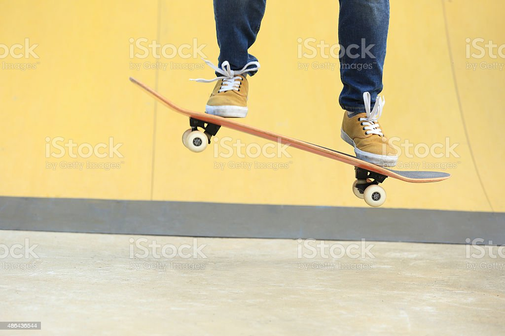 skateboarding at skatepark stock photo