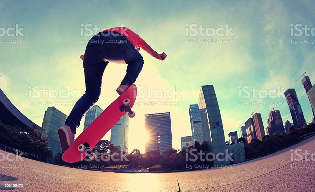 skateboarding at sunrise city stock photo