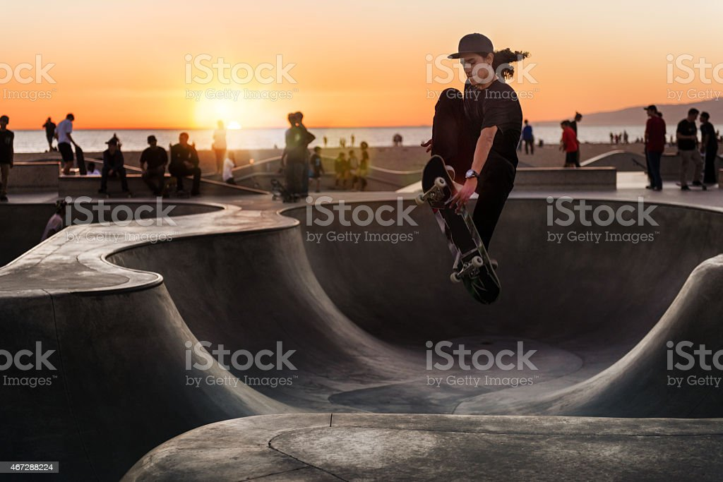 Skateboarding at Sunset stock photo