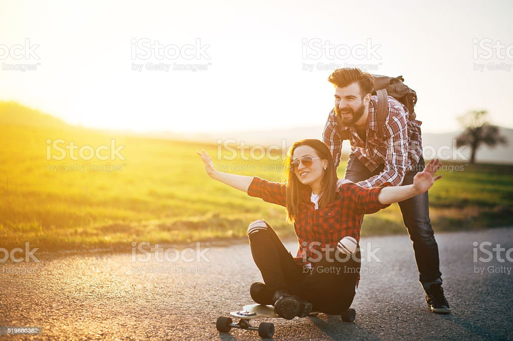 Skateboarding friends having fun stock photo