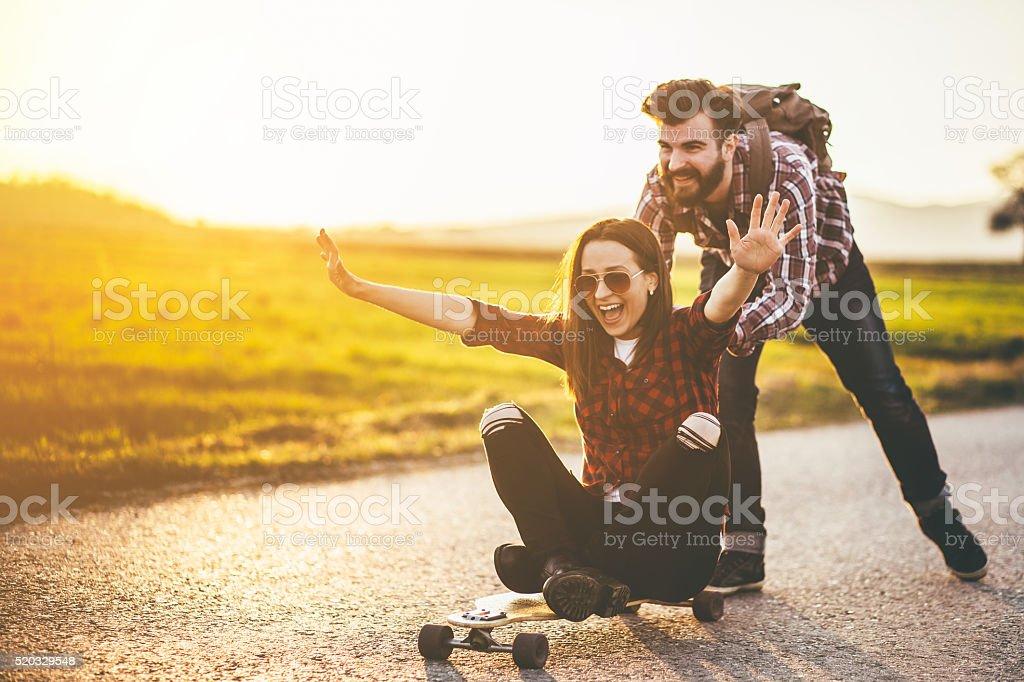Skateboarding friends having fun stock photo