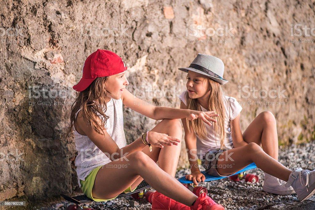 Skateboarding girls stock photo