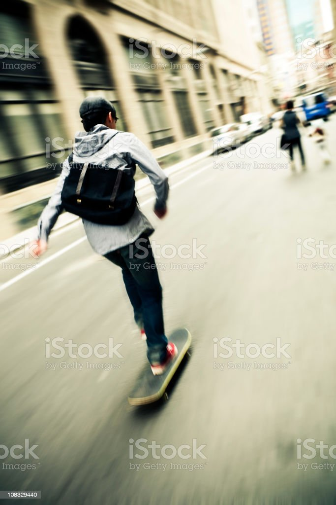Skateboarding in the street royalty-free stock photo