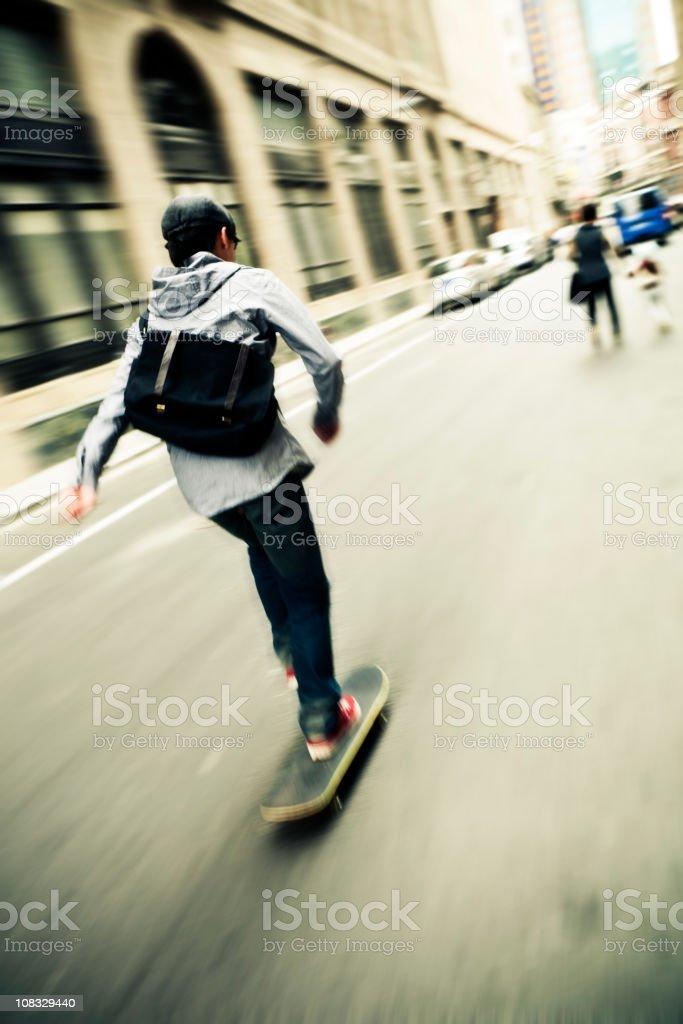 Skateboarding in the street stock photo