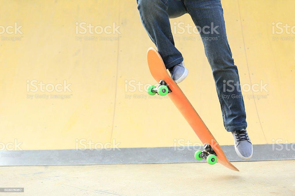 skateboarding legs at skatepark stock photo