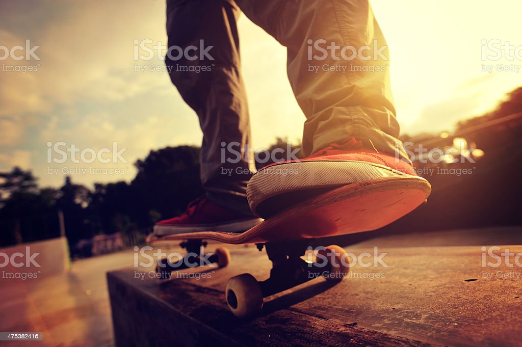 skateboarding legs sunrise skatepark stock photo
