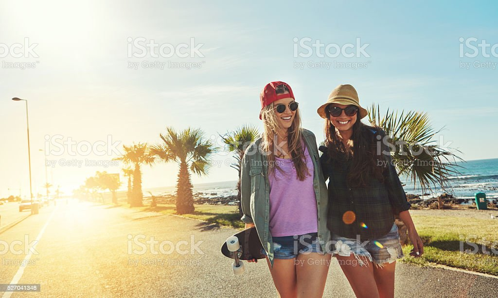 Skateboarding the summer away stock photo