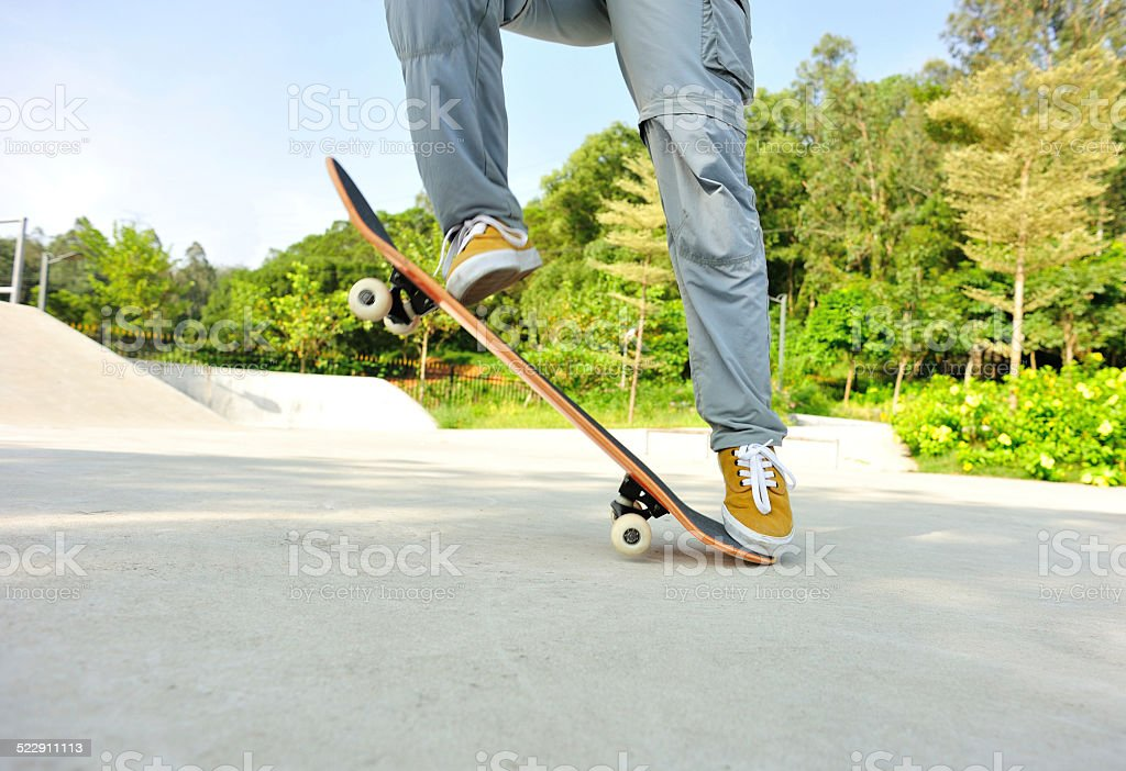 skateboarding woman jumping stock photo
