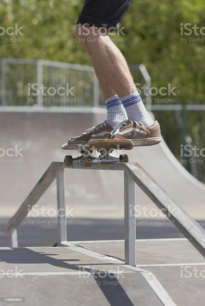 Skater doing 50-50 grind on fun-box in skatepark royalty-free stock photo