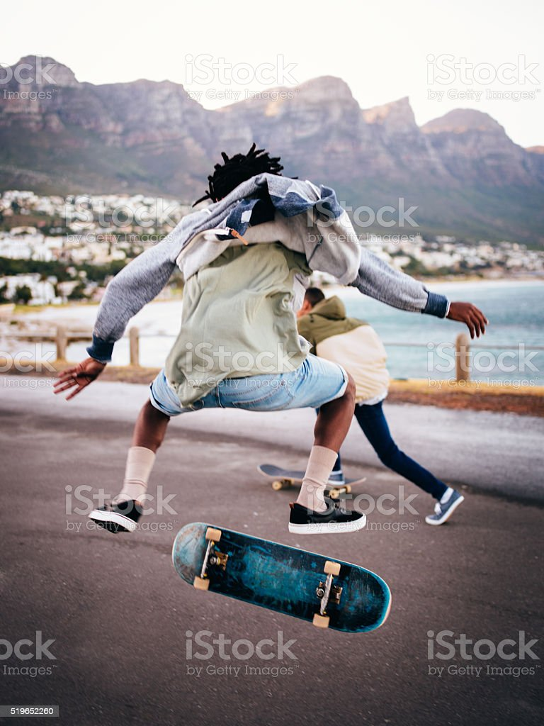 Skater Doing an Ollie on a Road on the Seaside stock photo