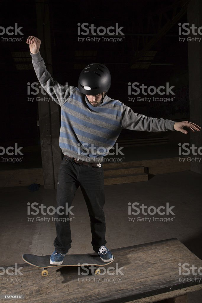 Skater doing manual trick royalty-free stock photo