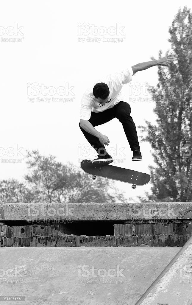 skater flip jump stock photo