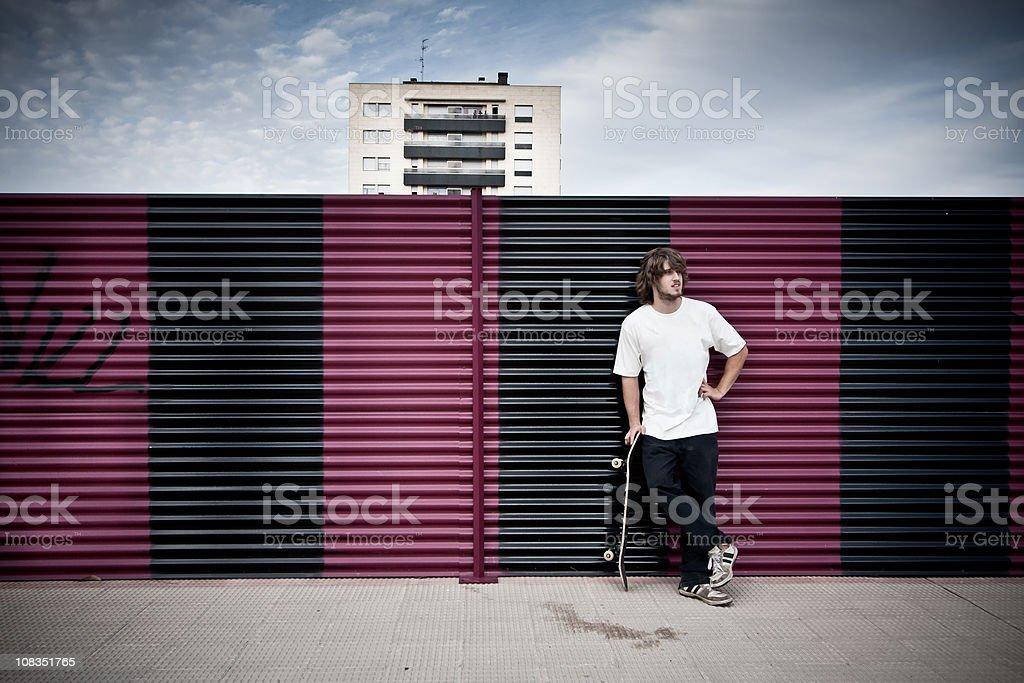 Skater holding his skateboard royalty-free stock photo