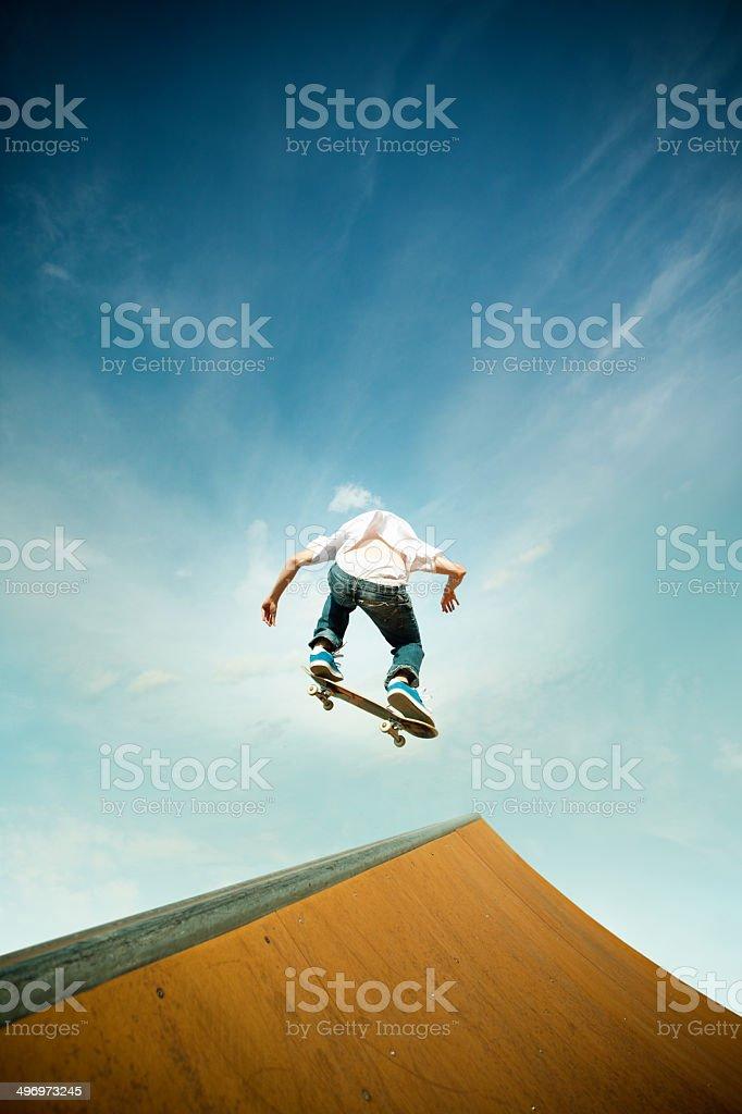 skater in jump over skating poligon ramp stock photo